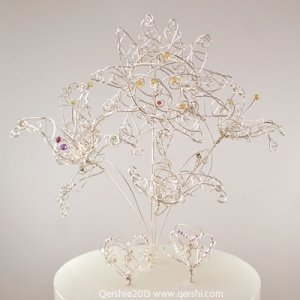 A bouquet of flowers and hearts designed to adorn your wedding cake.